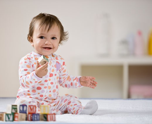 Hispanic baby playing with blocks : Stock Photo
