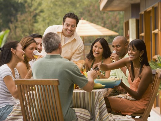 Stock Photo: 1589R-50265 Multi-ethnic friends eating outdoors