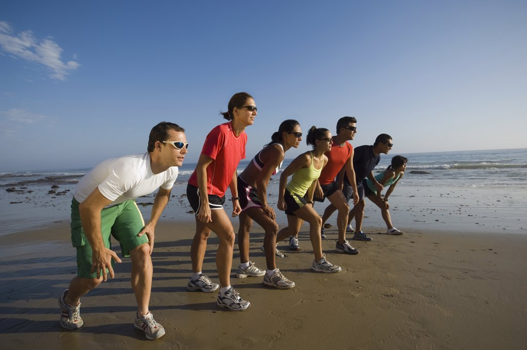 Stock Photo: 1589R-50337 Multi-ethnic runners racing at beach