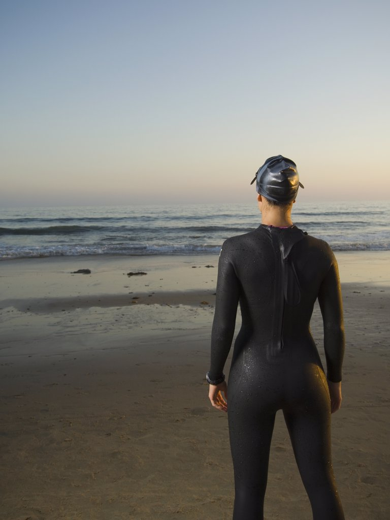 Stock Photo: 1589R-50379 Rear view of Hispanic woman wearing wetsuit
