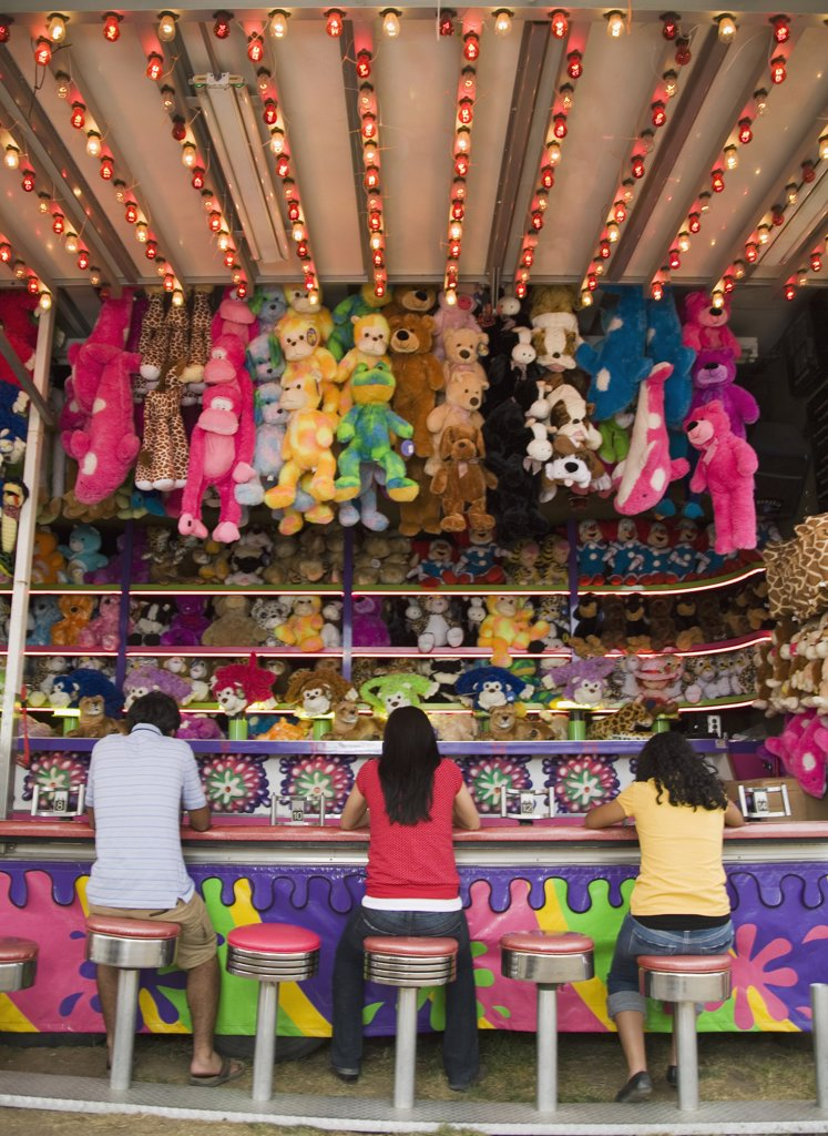 Stock Photo: 1589R-50456 Multi-ethnic teenaged friends playing carnival game