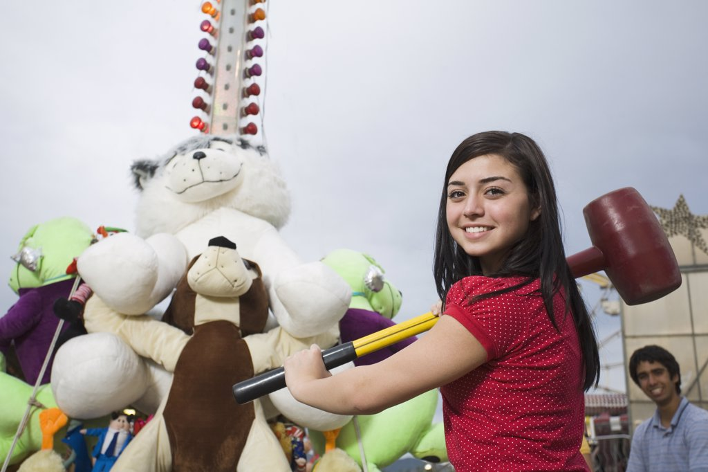 Stock Photo: 1589R-50466 Mixed Race teenaged girl playing carnival game