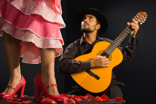 Stock Photo: 1589R-50492 Hispanic female flamenco dancer next to guitar player