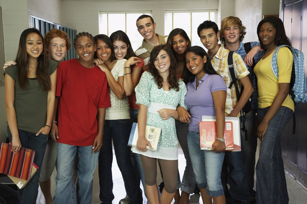 Group of multi-ethnic teenagers in school hallway : Stock Photo