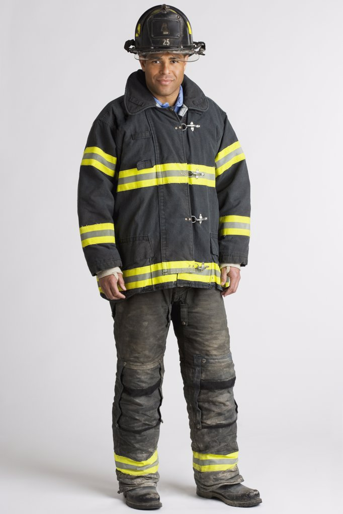 Portrait of Hispanic male firefighter : Stock Photo