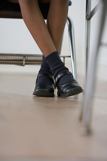 African American girl's legs in classroom : Stock Photo