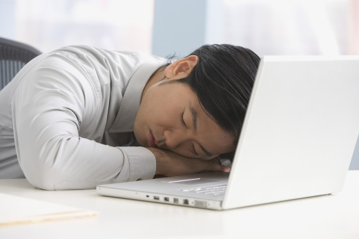 Stock Photo: 1589R-51043 Asian businessman sleeping on laptop