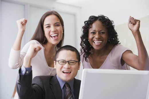 Multi-ethnic businesspeople cheering : Stock Photo