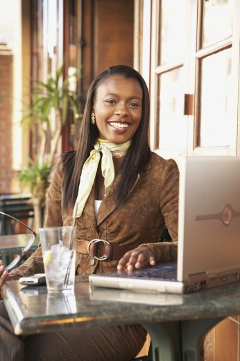 Stock Photo: 1589R-51368 African American businesswoman at cafe