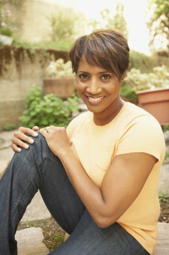 Stock Photo: 1589R-51371 African American woman sitting outdoors