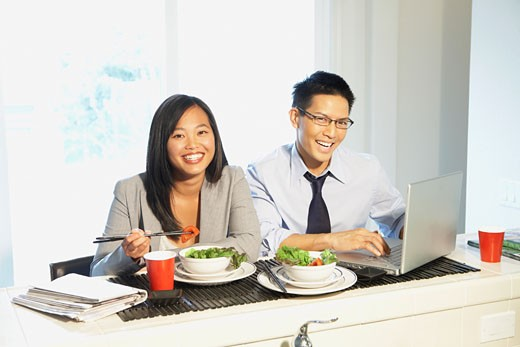 Stock Photo: 1589R-51434 Asian couple eating breakfast