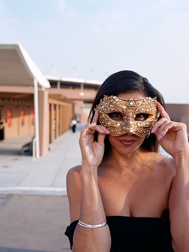 Stock Photo: 1589R-51520 Hispanic woman wearing mask