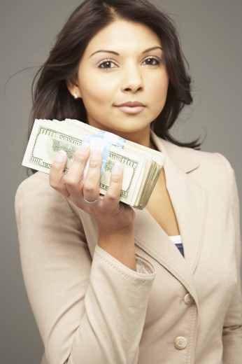 Stock Photo: 1589R-51620 Asian woman holding stack of money