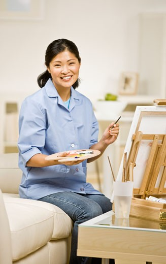 Stock Photo: 1589R-51839 Asian woman painting at easel