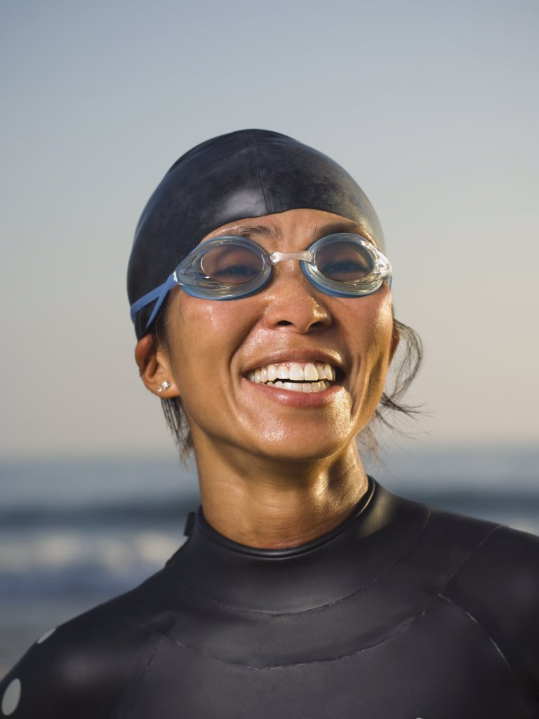 Asian woman wearing wetsuit and goggles : Stock Photo