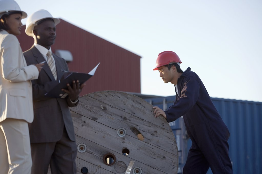 African American businesspeople at commercial pier : Stock Photo