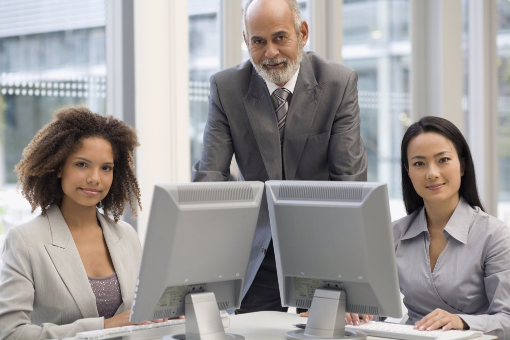 Stock Photo: 1589R-52330 Multi-ethnic businesspeople behind computers