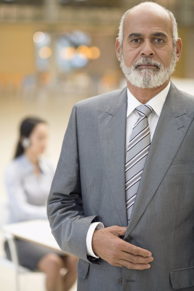 Stock Photo: 1589R-52334 Senior African businessman with hand on jacket
