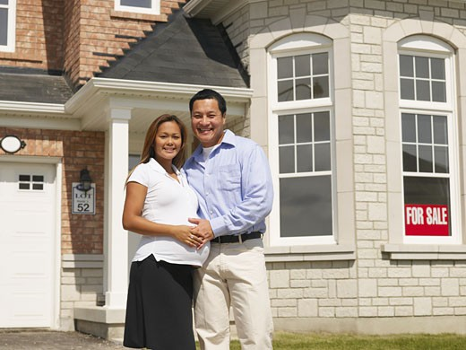Stock Photo: 1589R-52410 Pregnant Asian couple in front of new house