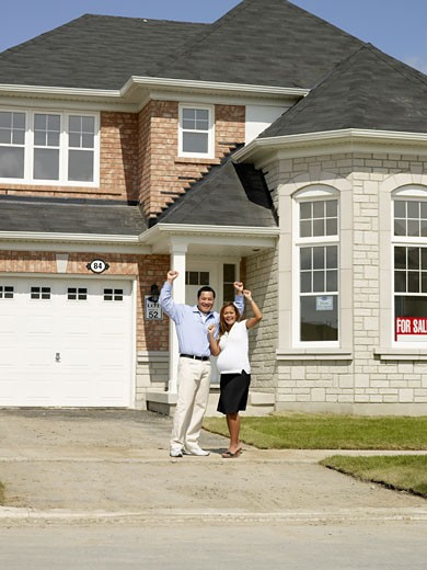 Stock Photo: 1589R-52411 Pregnant Asian couple in front of new house