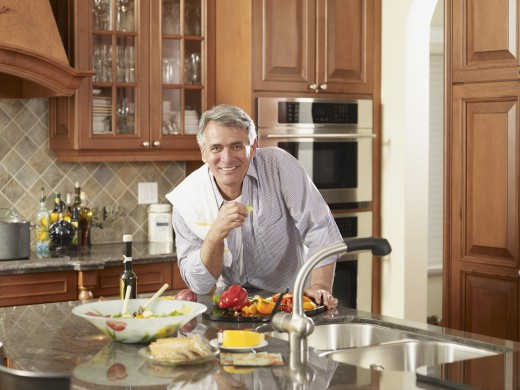 Hispanic man preparing food : Stock Photo