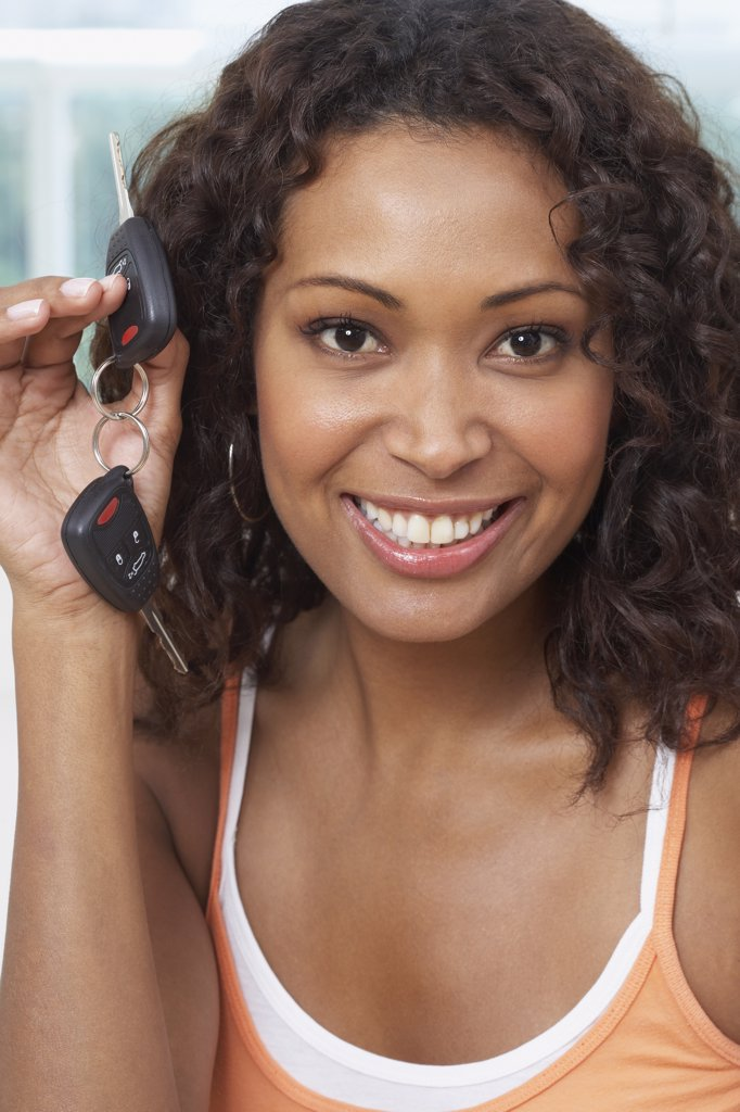 Stock Photo: 1589R-52632 African woman holding up car keys