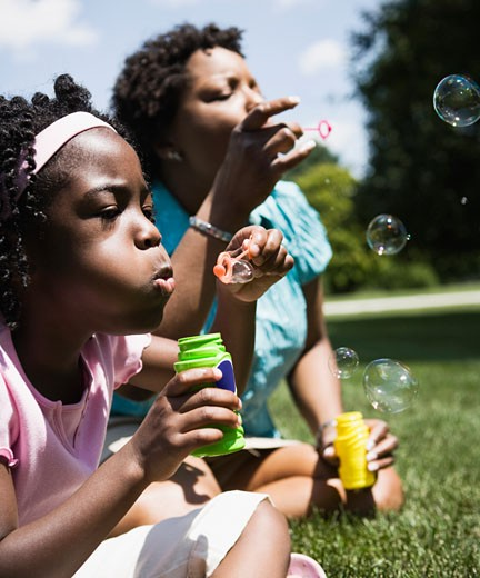 Stock Photo: 1589R-52687 African mother and daughter blowing bubbles