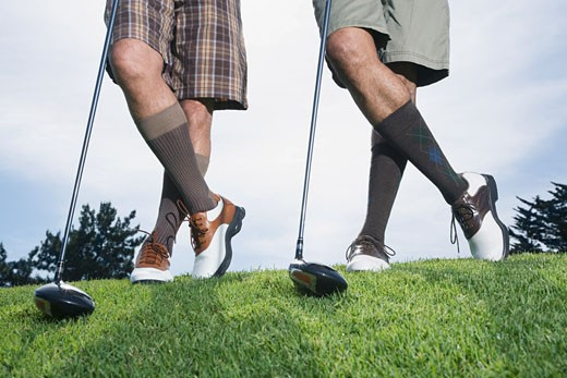 Stock Photo: 1589R-52738 Multi-ethnic men on golf course