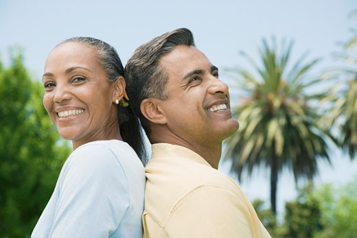 Stock Photo: 1589R-52784 Multi-ethnic couple standing back to back