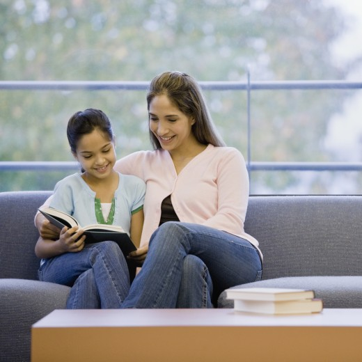 Stock Photo: 1589R-53065 Mixed Race mother and daughter reading