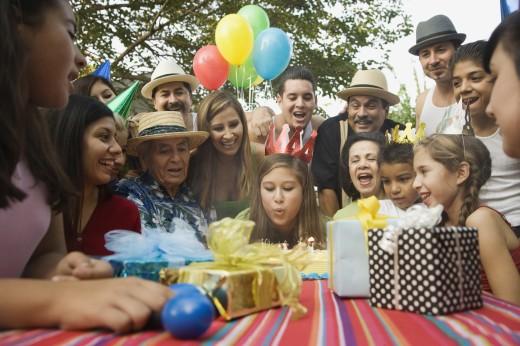 Stock Photo: 1589R-53416 Hispanic girl celebrating birthday with family