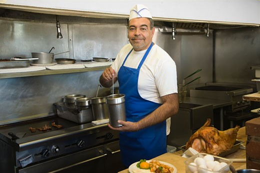 Stock Photo: 1589R-53516 Hispanic male cook in kitchen