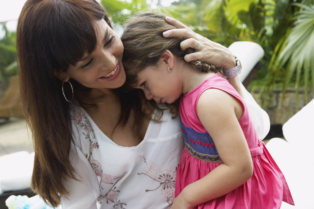 Stock Photo: 1589R-53611 Hispanic mother hugging sad daughter