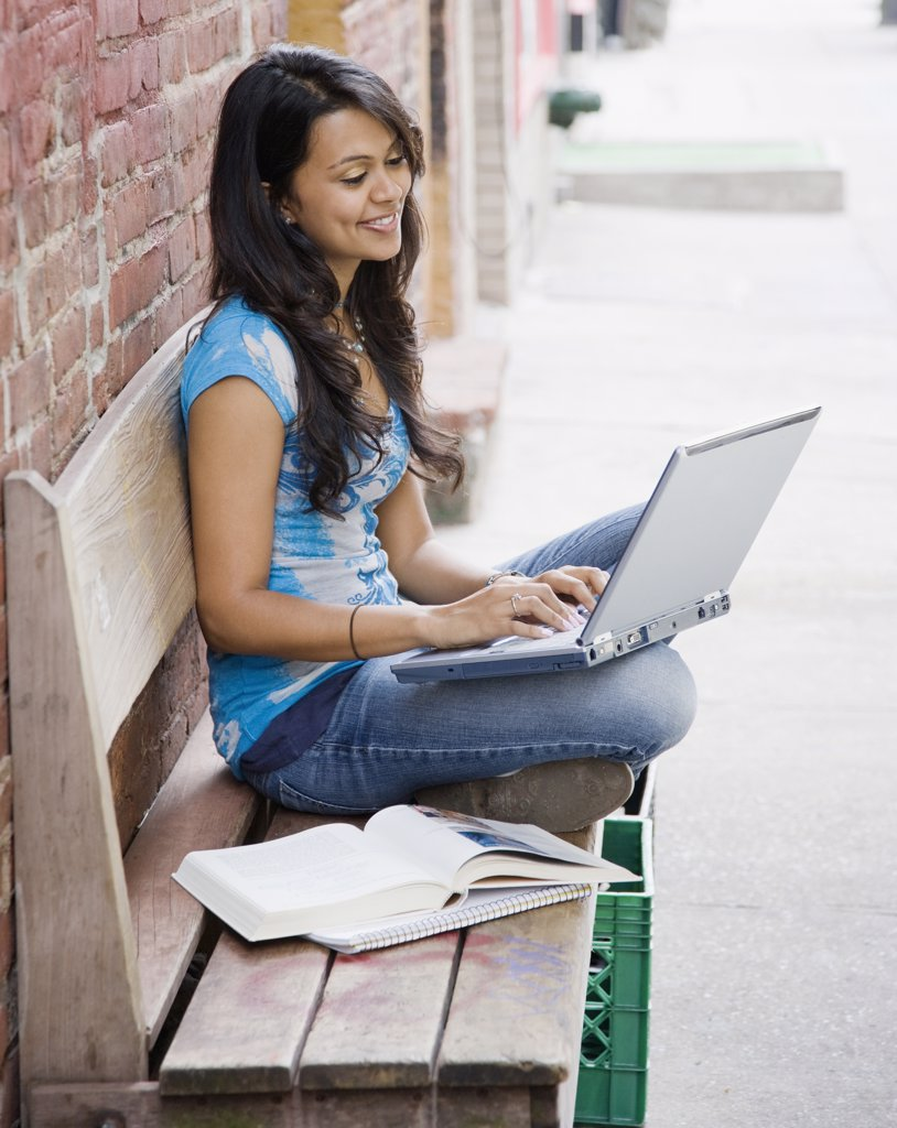 Stock Photo: 1589R-53753 Mixed Race woman typing on laptop