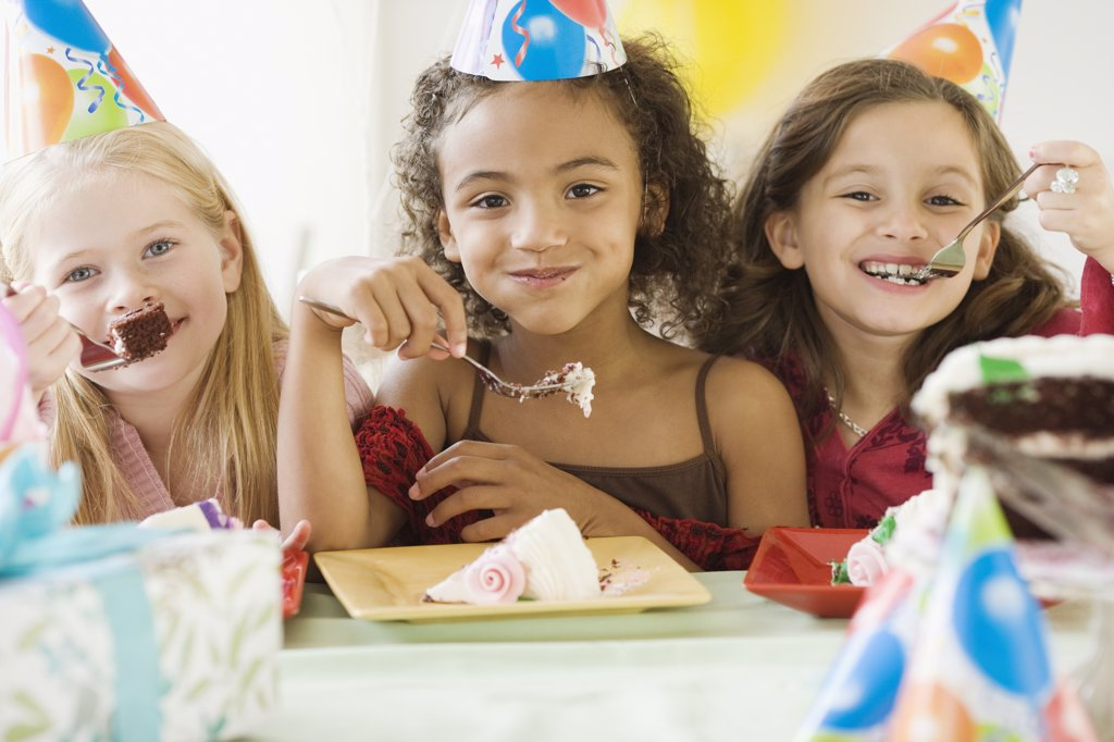 Stock Photo: 1589R-53797 Multi-ethnic girls eating birthday cake