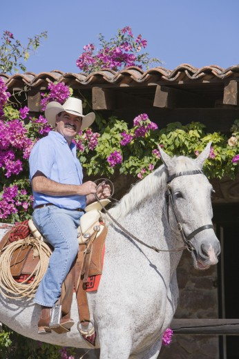 Stock Photo: 1589R-54037 Hispanic man riding horse