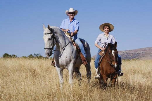 Stock Photo: 1589R-54042 Hispanic couple riding horses