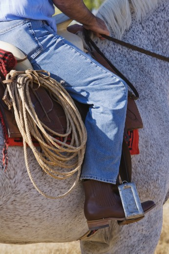 Stock Photo: 1589R-54045 Hispanic man riding horse