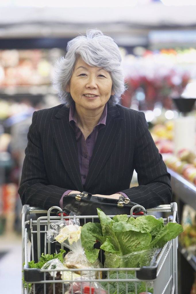 Stock Photo: 1589R-54172 Senior Asian woman in grocery store