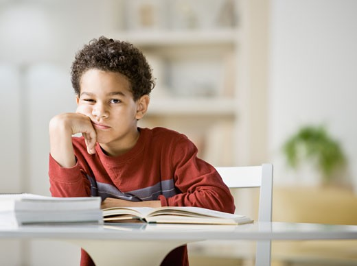 Stock Photo: 1589R-54606 African boy doing homework