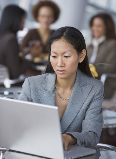 Stock Photo: 1589R-54630 Asian businesswoman looking at laptop