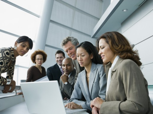 Stock Photo: 1589R-54642 Multi-ethnic businesspeople looking at laptop