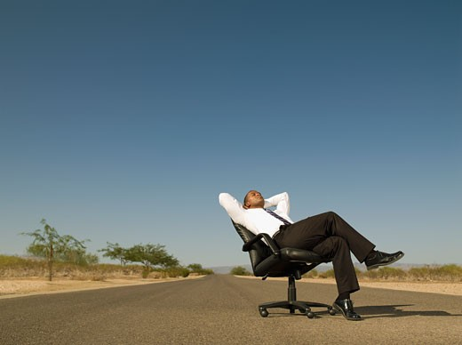 Stock Photo: 1589R-54735 African businessman sitting in middle of road