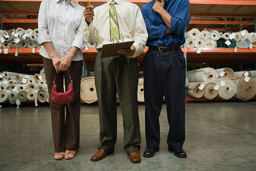 Stock Photo: 1589R-54777 Sales clerk and customers in fabric warehouse