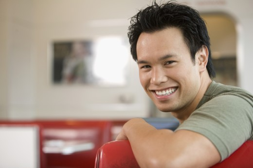 Stock Photo: 1589R-54804 Asian man sitting in diner booth