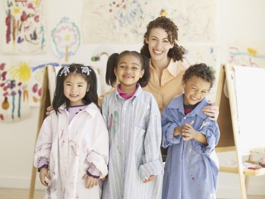 Stock Photo: 1589R-55486 Hispanic female art teacher with multi-ethnic students