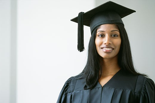 Stock Photo: 1589R-55496 Indian woman wearing graduation cap and gown
