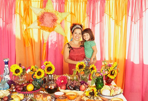 Stock Photo: 1589R-55611 Mixed Race mother and daughter behind buffet table