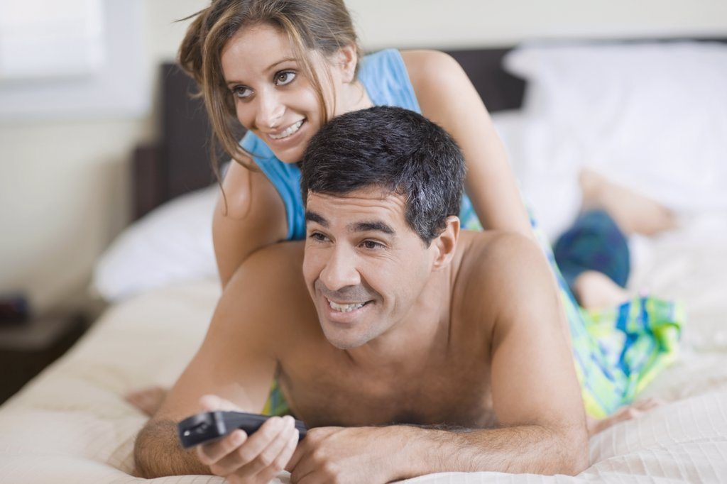 Stock Photo: 1589R-55964 Hispanic couple watching television