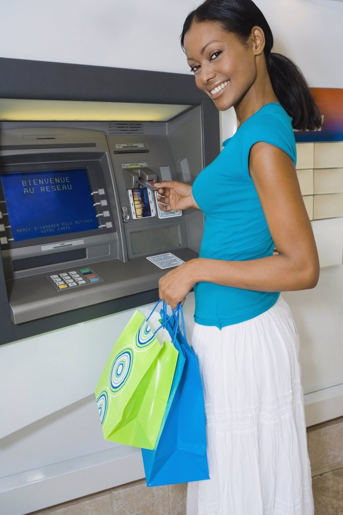 Hispanic woman using atm : Stock Photo